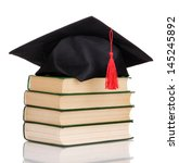 grad hat with books isolated on ... | Shutterstock . vector #145245892