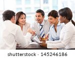 group of business people in a... | Shutterstock . vector #145246186