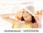 woman sunbathing and relaxing... | Shutterstock . vector #145253356