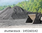 Stockpile of Coal with End Loader - stock photo