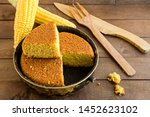Stock photo fresh delicious sliced of cornbread on the wooden table with wood knife fork and corncobs 1452623102