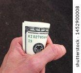 macro photo of us dollars in... | Shutterstock . vector #1452900008