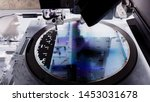 Small photo of Close up silicon wafer negative color in die attach machine in semiconductor manufacturing