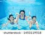 Family Swims In Pool Underwater ...
