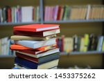 stack of books in library | Shutterstock . vector #1453375262
