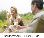 blurred man looking at a happy... | Shutterstock . vector #145432135