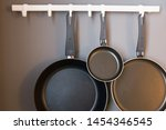 Frying Pans Hanging In The...