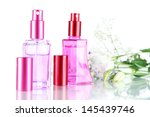 perfume in bottles and flowers... | Shutterstock . vector #145439746
