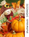 Cute Scarecrow And Pumpkins On...