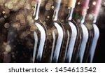 closeup of dark wine bottles in ...   Shutterstock . vector #1454613542