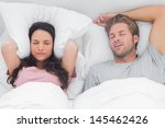 woman annoyed by the snoring of ... | Shutterstock . vector #145462426