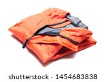 Small photo of Folded orange zipper windbreaker jacket, rain proof and waterproof hiking Gore-Tex jacket hoodie. Track jacket sport nylon full zip isolated on white. Folded clothes. Outer layer garment for travel.