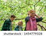 woman clamps her ears  seeking... | Shutterstock . vector #1454779328