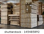 Stacks Of Plywood Piled Up In...