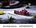 a slice of chocolate clafouti... | Shutterstock . vector #1454898392