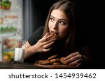 Woman Eats Sweets At Night To...