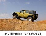 bafokeng   may 18  green jeep... | Shutterstock . vector #145507615