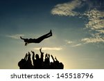 group throwing girl in the air | Shutterstock . vector #145518796