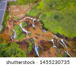 Aerial View Of Golden Waterfal...