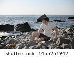 young stylish man outdoor...   Shutterstock . vector #1455251942