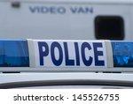 Closeup Of Police Car Sign Wit...