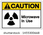 caution microwave in use symbol ... | Shutterstock .eps vector #1455300668