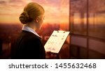 lady standing on office center... | Shutterstock . vector #1455632468