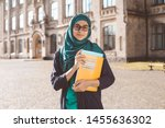 smiling muslim young female... | Shutterstock . vector #1455636302