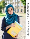 smiling muslim young female... | Shutterstock . vector #1455636305