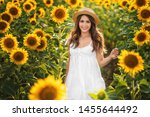 Stock photo beautiful girl in hat in a sunflower field th of july fourth of july freedom 1455644492