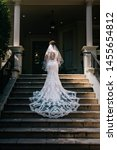a bride standing on the steps... | Shutterstock . vector #1455654812
