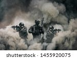 Swat forces between smoke and gas in battle field - stock photo
