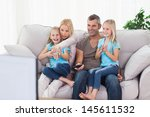 cute twins and parents watching ... | Shutterstock . vector #145611532