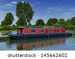 red narrow boat at a mooring on ...