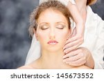 pretty woman on head massage... | Shutterstock . vector #145673552