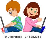 Boy and girl operating laptop