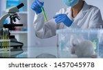 scientist mixing test liquid in ... | Shutterstock . vector #1457045978