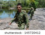 Small photo of LA MACARENA, COLOMBIA-NOVEMBER 6: Military forces of Colombia supervise territories where guerrillas of FARC still act.Soldiers patrol the mountain river in November 6; 2012 in La Macarenia;Colombia