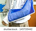 thai boy student's arm is broken | Shutterstock . vector #145735442