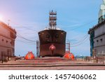 Cargo Ship Under Repair With...