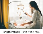 mother taking a picture of a...   Shutterstock . vector #1457454758