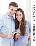 couple drinking wine  | Shutterstock . vector #145747382