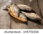 Dried Fish On Wooden Table