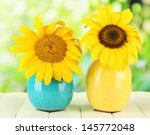 Bright Sunflowers In Vase On...