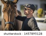 Race Horse Ownership Concept Photo. Successful Caucasian Men in His 60 Just Invested in New Horse. - stock photo
