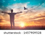 Small photo of Happy man rise hand on morning view. Christian inspire praise God on good friday background. Male self confidence empowerment on mission arm courage nature the sun concept strength wisdom