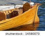 Antique boat with picnic basket in the stern - stock photo