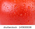 Water Drops On Red Tomato....