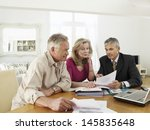 mature couple sitting at table... | Shutterstock . vector #145835648