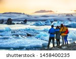 Small photo of Group of tourist looking Beautifull landscape with floating icebergs in Jokulsarlon glacier lagoon at sunset. Location: Jokulsarlon glacial lagoon, Vatnajokull National Park, south Iceland, Europe
